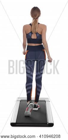 Sporty Woman Using Walking Treadmill On White Background, Back View