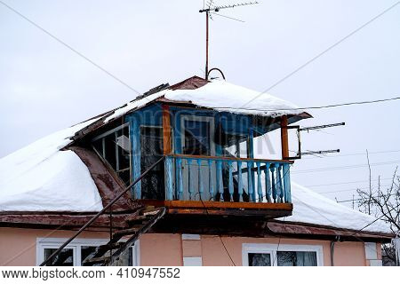 Bashkiria, Russia - 01.30.2021: Old Decrepit Open Balcony In The Russian Village. Superstructure On