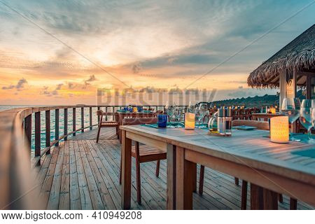 Summer Empty Outdoor Cafe Restaurant At Exotic Island Resort On The Seashore, Sunset Colorful Sky. I
