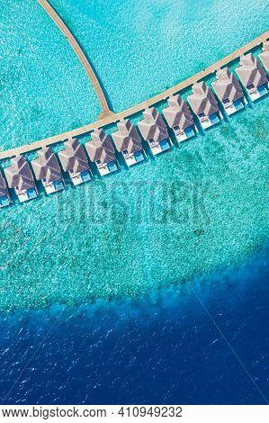 Aerial Photo Of Beautiful Maldives Paradise Tropical Beach. Amazing View, Blue Turquoise Sea Lagoon