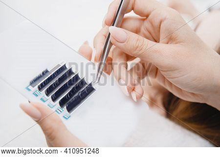 Woman Master Making Fake Long Lash Eyelash Extension Procedure
