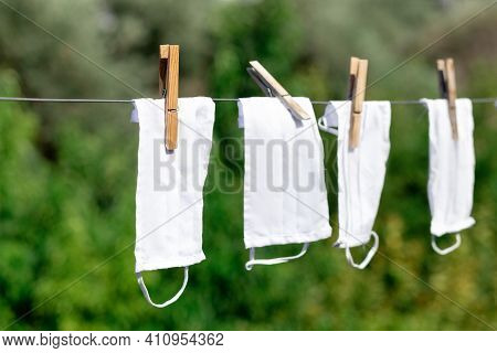 Reusable Medical Masks Hanging On Drying Equipment For Reuse. Masks To Protect Against Viruses And P