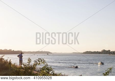 Belgrade, Serbia - August 29, 2020: Old Man, Grandfather, Observing Boats And Ships From The Danube