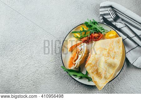 Crepes With Stuffed Cream Cheese And Salmon. Lunch Meal Food Concept. Top View.