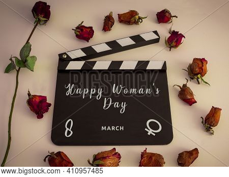 March 8, International Womens Day. Photo Taken With Rose With Happy Womens Day On Clapperboard.