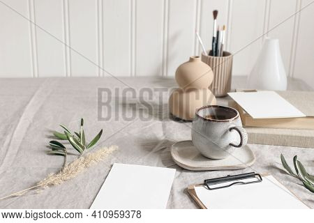 Artistic Wokspace, Still Life. Paint Brushes And Pencils. Olive Branches, Vase, Cup Of Coffee And Bl
