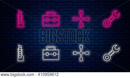 Set Line Toolbox, Wheel Wrench, Stationery Knife And Wrench Spanner. Glowing Neon Icon On Brick Wall