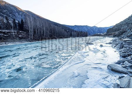 View Blue And Green River With Snow And Crushed Ice During An Ice Drift In Winter In The Altai Mount