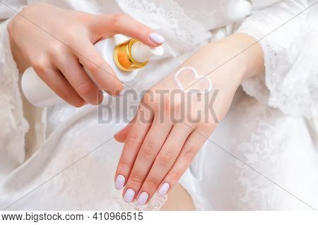 Beautiful Well-groomed Female Hands With Heart-shaped Cream On The Palm. Moisturizing Cream For Clea
