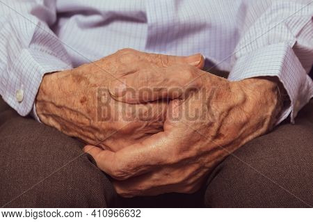 Unrecognizable Caucasian Very Old Man's Hands. Close-up. Grandfather's Hands In Blue Shirt. The Hard