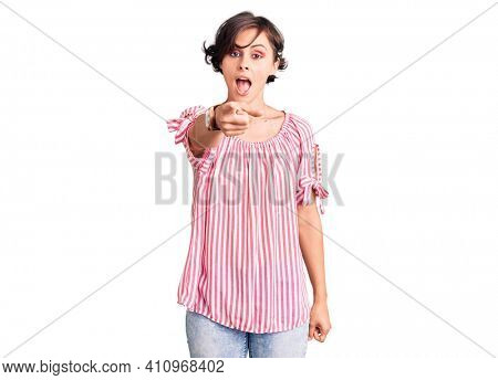 Beautiful young woman with short hair wearing casual summer clothes pointing displeased and frustrated to the camera, angry and furious with you
