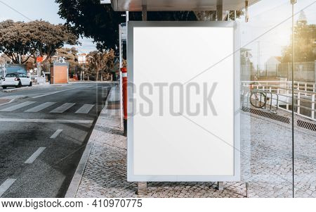 A City Glass Bus Stop With A Mockup Of A Blank Advert Billboard Inside; A Template Of An Empty Adver