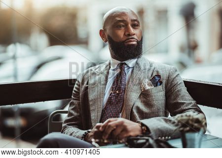 Portrait Of A Dapper Mature Hairless Black Man Entrepreneur With A Nice Beard, In A Custom Elegant G