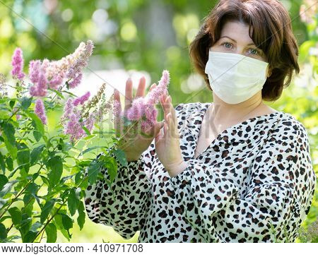 Allegria Woman With Mask On Face Near Flowering Bush