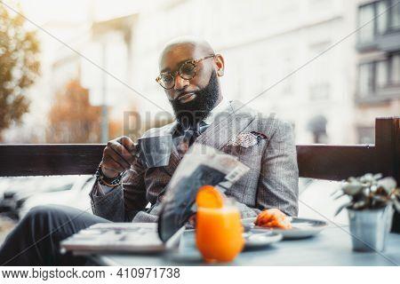 Portrait Of A Baldheaded Adult Black Dandy Guy With A Well-groomed Beard, In A Custom Made Elegant C