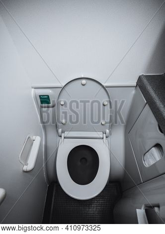 A Wide-angle Vertical View Of A Part Of The Interior And A Lavatory Bowl With The Lid Open Indoors O