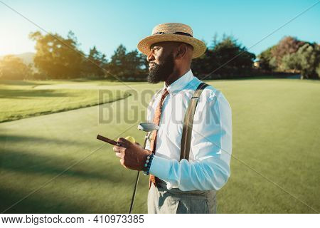 A Portrait Of A Handsome Dapper Bearded Black Man In An Elegant Outfit: White Shirt, Trousers With S