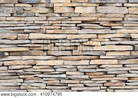 Stone Wall Of Natural Stones. Brickwall Texture Background. Stone Veneers, Cladding Wall Made Of Sta