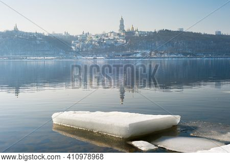 Dnipro River And Kyiv-pechersk Lavra Monastery In The Spring. Ice In The Foreground. Kyiv, Ukraine