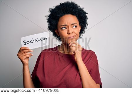 Young African American afro politician woman with curly hair socialist party member serious face thinking about question, very confused idea