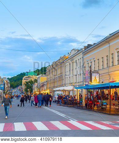 Kiev, Ukraine - May 31, 2020: People Walking By Old Town Street Of Kiev At Twilight.