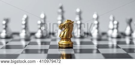 Gold  Chess Knight (horse) Figure On Chessboard Against Opponent Or Enemy. Strategy, Conflict, Manag