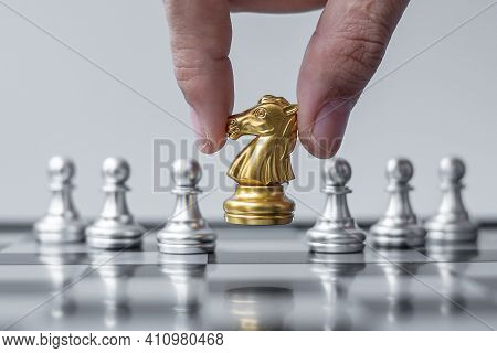 Gold Chess Knight Figure Stand Out From The Crowd On Chessboard Background. Strategy, Leadership, Bu
