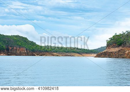 Landscape Of The Lake Of Furnas, Capitólio Mg, Brazil. Rock Walls Of On The Shore Of The Lake, Water