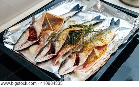 Home Coocing - View From Above Of Three Bass Lateolabrax Japonicus Fish Ready Stove Oven Seasoned Wi