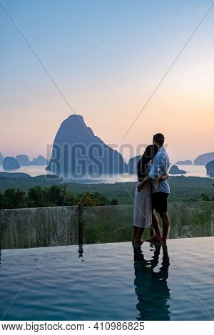 Couple Men And Woman Mid Age Watching Sunrise In Phangnga Bay Thailand, Phangan Bay Viewpoint, Coupl