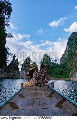 Couple On Longtail Boat Visiting Khao Sok National Park In Phangnga Thailand, Khao Sok National Park
