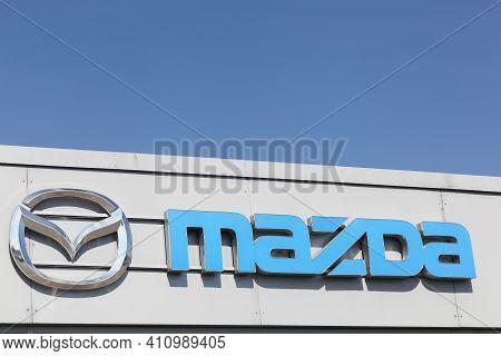 Fredericia, Denmark - September 10, 2016: Mazda Logo On Dealer Facade. Mazda Is A Japanese Automaker