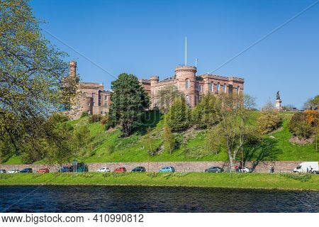 Inverness Castle Over The River Ness Against Blue Sky In Scotland, United Kingdom Of Great Britain A