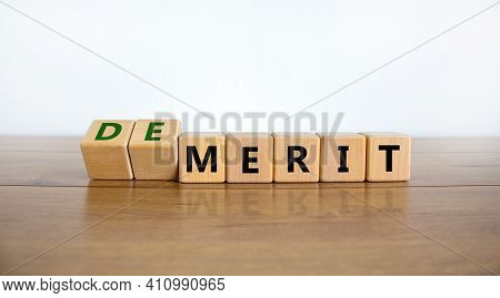 Demerit Or Merit Symbol. Turned Wooden Cubes And Changed Words 'demerit' To 'merit'. Beautiful Woode