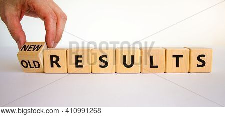New Vs Old Results Symbol. Businessman Turns The Wooden Cube And Changes Words 'old Results' To 'new