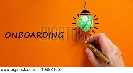 Onboarding Symbol. Businessman Writing The Word 'onboarding', Isolated On Beautiful Orange Backgroun