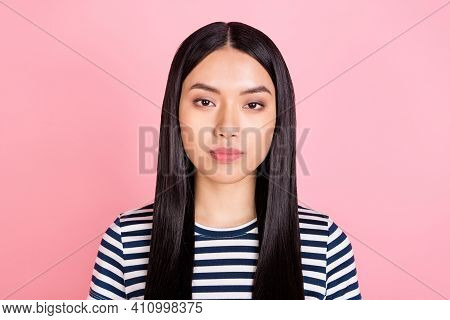 Photo Of Serious Adorable Charming Young Lady Wear Striped T-shirt Isolated Pink Color Background
