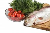 Salmon on the cutting board with greenery. Isolated poster