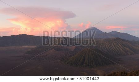 Sunrise over valley with volcanoes Bromo (left crater), Batok (right), Semeru (on the horizon). Java island, Indonesia