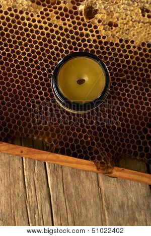 Honeycomb With Fresh Honey And A Vase With Cera Balsam