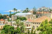 A view of the historic city of Byblos in Lebanon from the crusaders' castle and the ancient St. John the Baptist Church. poster