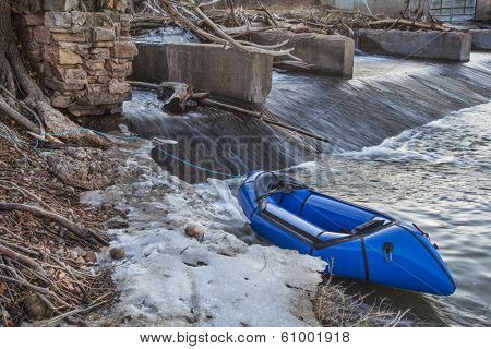 a packraft (one-person light raft used for expedition or adventure racing) below a diversion dam  - Cache la Poudre River, Fort Collins, Colorado