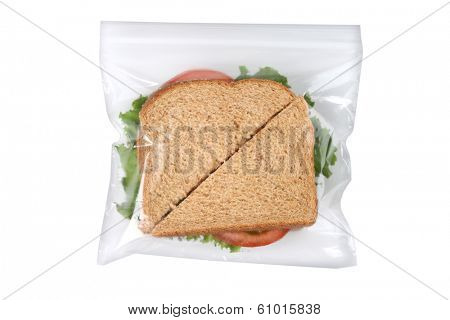 Sandwich in plastic bag, cutout on white background