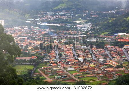 Misty Brazilian town in the middle of hills
