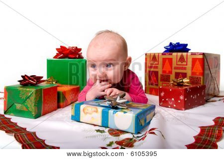 Baby Lying Amongst Christmas Gifts