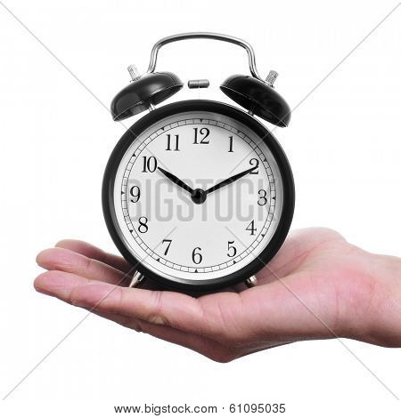 a man holding a typical mechanical alarm clock on a white background poster