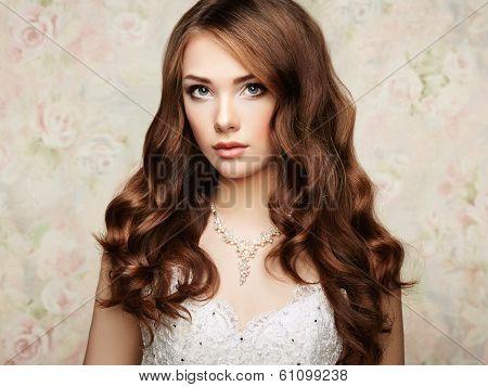 Portrait of beautiful sensual woman with elegant hairstyle. Wedding dress. Fashion photo poster