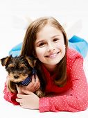 Young girl with  puppy, cute Yorkshire terrier  - best friends poster