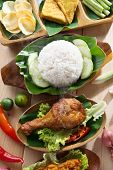 Popular Indonesian local food nasi ayam penyet, indonesian fried chicken rice. Fresh hot with steam smoke. poster