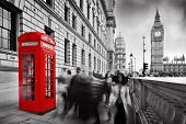 Red telephone booth and Big Ben in London, England, the UK. People walking in rush. The symbols of London in black on white. poster
